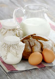 Homemade yogurt, milk and bread on a wooden table Royalty Free Stock Photos