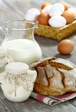Homemade yogurt, milk and bread on a wooden table Stock Photo