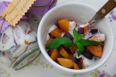 Homemade yogurt with pieces of plum Royalty Free Stock Photo