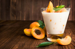 Homemade yogurt with ripe apricots Royalty Free Stock Photography