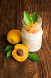 Homemade yogurt with ripe apricots Stock Photo