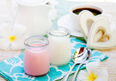 Homemade yogurt strawberry and vanilla in glass jars Romantic breakfast background with wooden heart Stock Images