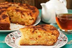 Homemade yummy apple pie, black tea and white teapot on turquois. E table closeup horizontal Royalty Free Stock Images