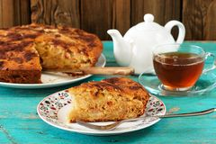 Homemade yummy apple pie, black tea and white teapot on turquois Royalty Free Stock Photos