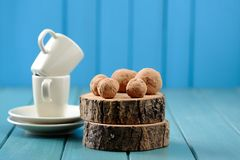 Homemade yummy chocolate balls on wood slabs with coffee cups on Royalty Free Stock Image