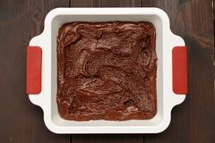 Homemade yummy chocolate cake in white square baking pan on wood. En table above Royalty Free Stock Image