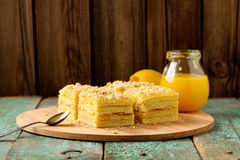 Homemade yummy layered lemon cake served with tea and lemon curd Royalty Free Stock Images
