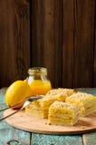 Homemade yummy layered lemon cake served with tea and lemon curd Stock Image