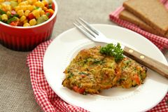 Homemade zucchini fritters with chorizo sausage and corn salsa Stock Image