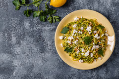 Homemade Zucchini  Zoodles Pasta with Pine nuts and Feta. Homemade Zucchini  Zoodles Pasta with Pine nuts and Feta, top view Stock Images