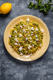 Homemade Zucchini  Zoodles Pasta with Pine nuts and Feta. Homemade Zucchini  Zoodles Pasta with Pine nuts and Feta, top view Royalty Free Stock Image