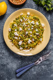 Homemade Zucchini  Zoodles Pasta with Pine nuts and Feta. Stock Image