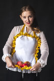 Homemaker with apples in apron Stock Photography