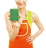 Homemaker in an apron holding a sponge washer Stock Images