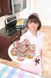 Homemaker holding plate of cupcakes Stock Image