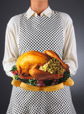 Homemaker Holding Turkey on a Platter Royalty Free Stock Photography