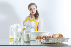 Homemaker in kitchen Royalty Free Stock Image