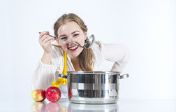 Homemaker in with ladle Royalty Free Stock Photo