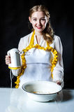Homemaker with mixer and bowl Stock Images