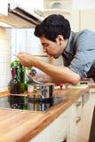 Homemaker tasting soup Stock Photo