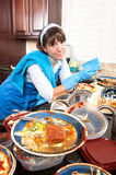 Homemaker washing dishes Stock Image