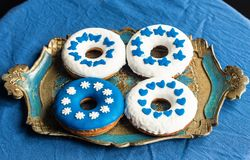 Decorated doughnuts with sugarpaste. Homemamde doughnuts decorated with white and blue sugarpaste royalty free stock photo