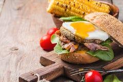 Homemmade Bacon Hamburger with fried Egg Stock Photos