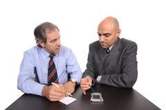 Homens de negócio em uma reunião fotografia de stock