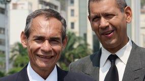Homens de negócio mais idosos de sorriso imagens de stock royalty free
