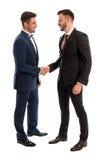 Homens de negócio que agitam as mãos Imagem de Stock