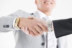 Homens de negócio que agitam as mãos Imagens de Stock Royalty Free