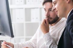 Homens de negócios contemplativos Imagens de Stock