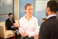 Homens de negócios e mulher de negócios Fotografia de Stock Royalty Free