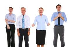 Homens de negócios e mulheres de negócios que exulting fotografia de stock
