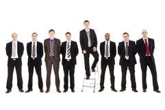 Homens de negócios em uma fileira Fotos de Stock Royalty Free