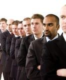 Homens de negócios em uma linha Imagem de Stock