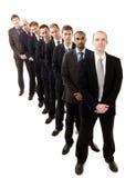 Homens de negócios em uma linha Imagens de Stock Royalty Free