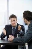 Homens de negócios na discussão foto de stock royalty free