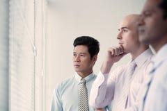 Homens de negócios pensativos Fotos de Stock Royalty Free