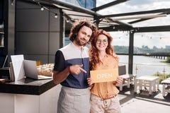 Homens de negócios prometedores que abrem seu restaurante novo fotos de stock royalty free