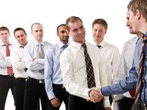 Homens de negócios que agitam as mãos fotos de stock royalty free