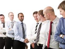 Homens de negócios que agitam as mãos imagem de stock