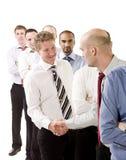 Homens de negócios que agitam as mãos imagem de stock royalty free