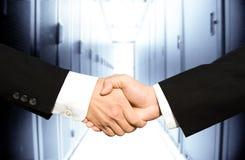Homens de negócios que agitam as mãos Imagens de Stock Royalty Free