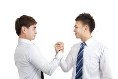 Homens de negócios que prendem a mão para a cooperação Foto de Stock Royalty Free