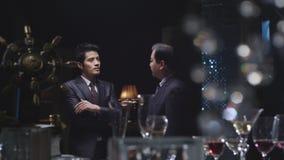 Homens de negócios na conversação Fotos de Stock Royalty Free