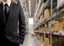 Homens de negócios no armazém Imagem de Stock