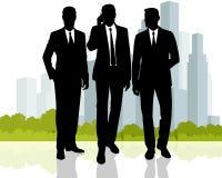 Homens de negócios no fundo da cidade Imagens de Stock Royalty Free
