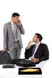 Homens de negócios que esperam pacientemente Imagens de Stock Royalty Free
