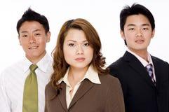 Homens e mulher de negócio Fotografia de Stock Royalty Free